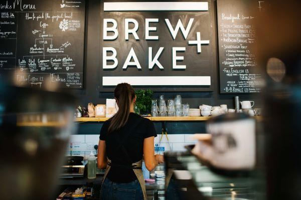 Waitress making coffee in the Brew + Bake Cafe inside Market Hall, Preston