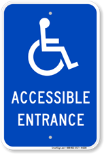 A blue sign with the wheelchair icon saying Accessible Entrance.