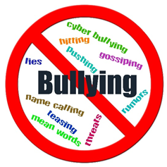 A sign with a red cross through it with the words No bullying.