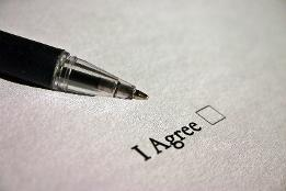 A pen with a tick box of I agree