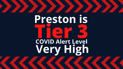 A sign saying Preston Tier 3 - Covid alert level very high