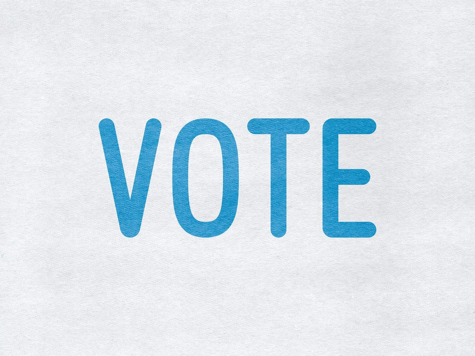 Vote - word on paper background.